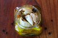 Garlic confit preserved in olive oil with herbs an Royalty Free Stock Photo