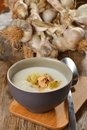 Garlic cream soup with croutons and almonds Royalty Free Stock Photo