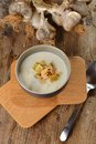 Garlic cream soup with croutons and almonds Royalty Free Stock Images