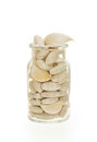Garlic and herbal supplement pills isolated Royalty Free Stock Photo