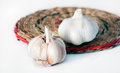 Garlic lying on a light background Royalty Free Stock Images