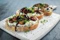 Garlic mushroom toast with creamy herbed ricotta chees spread Royalty Free Stock Photo