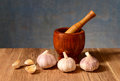 Garlic And Object Made Of Wood