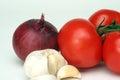 Garlic, onion and tomato Royalty Free Stock Photo