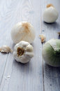 Garlic and onions closeup of a on a wooden table Royalty Free Stock Images