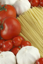 Garlic, pasta and tomatoes Stock Image