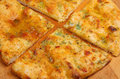Garlic pizza bread with sunblush tomatoes and herbs Stock Photography