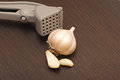 Garlic press with crushed bulb Stock Photos
