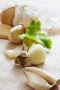 Garlic raw on stripes Stock Photography
