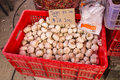 Garlic in red plastic box selling in the street market Stock Image