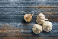 Garlic on wood surface.