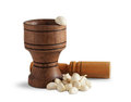 Garlic and wooden mortar Stock Photography