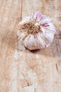 Garlic on a wooden table close up Stock Photos