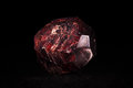 Garnet mineral stone in front of black crystal Royalty Free Stock Photography
