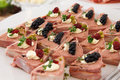 Garnished with blackberry pate wrapped in bacon on white plate Royalty Free Stock Images