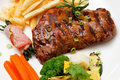 Garnished plate of grilled steak meat Royalty Free Stock Photos