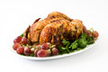 Garnished roasted turkey with grapes and herbs