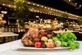 Garnished roasted turkey on platter on marble surface Royalty Free Stock Photo
