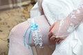 Garter on leg of bride Stock Images