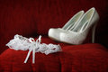 Garter a white and shoes shallow depth of field Royalty Free Stock Images