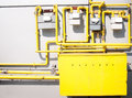 Gas connections painted in yellow on the side of a building Stock Images