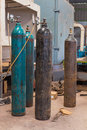 Gas cylinder compressed argon or carbon dioxide or oxygen steel cylinders for welding in metal workshop Stock Photo