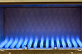 Gas flame blue flames of a burner inside of a boiler Royalty Free Stock Photography