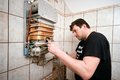 Gas furnace regulation a man doing Royalty Free Stock Photography