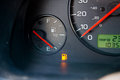 Gas guage empty a in a car reads and shows the warning light to let the driver know they are out of and need to refuel Royalty Free Stock Images