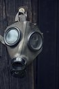Gas mask closeup of a on a wooden background Stock Photo