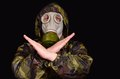 Gas mask a man in a warns of danger Royalty Free Stock Image