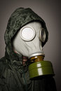 Gas mask man wearing a on his face Stock Images