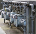 Gas meter row at angle Stock Images