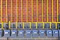Gas meters on brick wall row of natural with yellow pipes building Royalty Free Stock Photos
