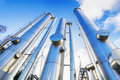 Gas pipes and pipelines construction large against clear blue sky inside refinery scene Royalty Free Stock Photos