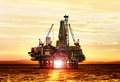 Gas production on the sea at sunrise platform Royalty Free Stock Photo