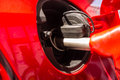 Gas pump closeup into car in station Stock Photo