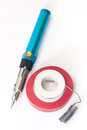 Gas soldering iron with tin and insulating tape Royalty Free Stock Photo