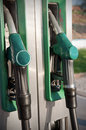 Gas station closeup of fuel nozzles at a gritty look Stock Photo