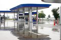 Gas station in raining day, Thailand. Royalty Free Stock Photo