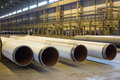 Gas supply pipes of large diameter are stacked in workshop the Stock Image
