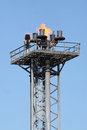 Gas terminal a photograph of burning on top of tower at Stock Photography