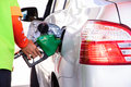 Gasoline car refilling close up scene of Royalty Free Stock Image