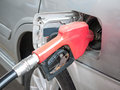 Gasoline nozzle filling up a car red Stock Photo