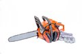 Gasoline powered modern chainsaw with protective gear and accesories isolated on white background Stock Photography