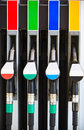 Gasoline pump nozzles at petrol station Stock Photography