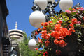 Gastown flower basket vancouver a heritage street lamp and hanging in the heart of s historic in the background is the lookout Stock Images