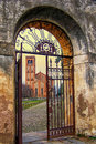 A gate and church in monselice italy the romanesque gothic cathedral of san giustina peeking through charming city northern Royalty Free Stock Photos