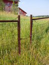 Gate entrance to farm with tall grass Stock Photography