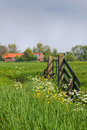 Gate and farm in Dutch country landcape Royalty Free Stock Image